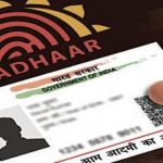 Two Aadhaar cards issued with the same number but different date of births.